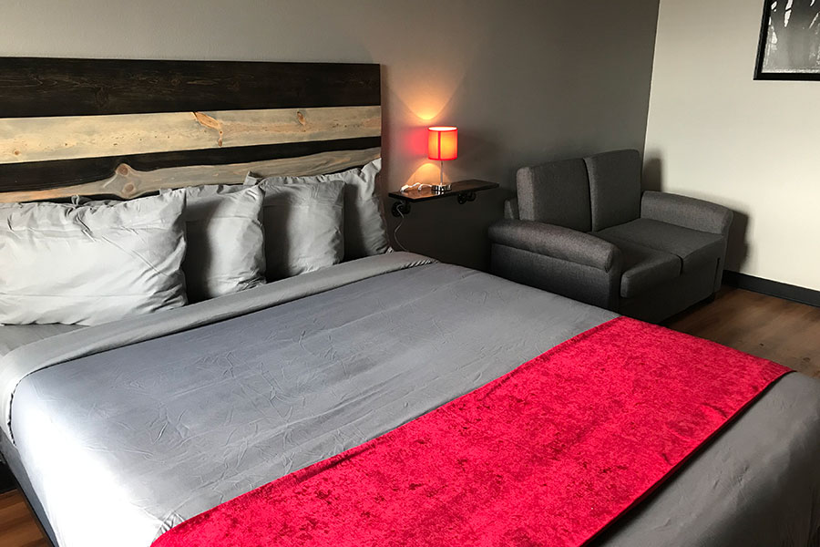 guestroom with king bed and sofa